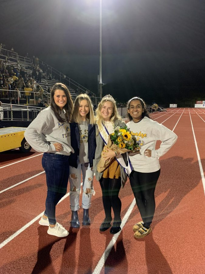 Swain smiles with the THS homecoming queens from the last three years.