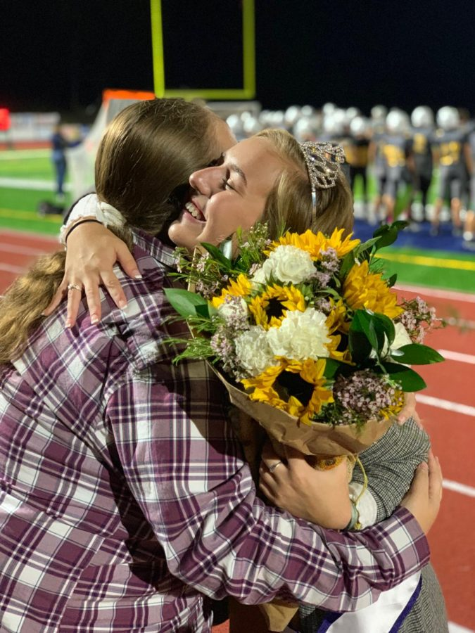 Swain hugs her sister, Alexis Swain, after winning Homecoming queen.