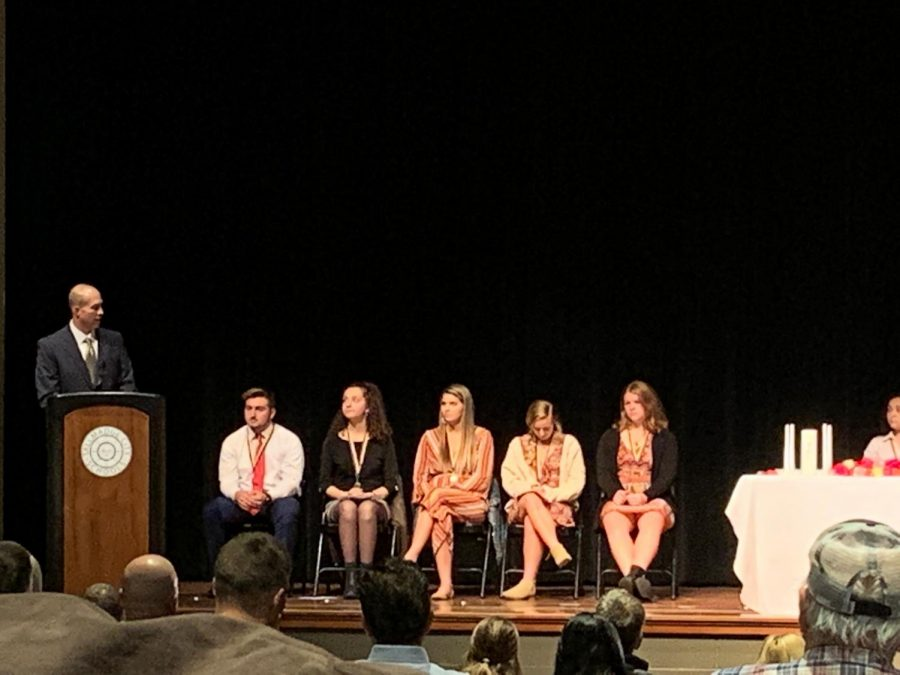 Athletic Director Tim Mosher gives his speech at the NHS induction ceremony.