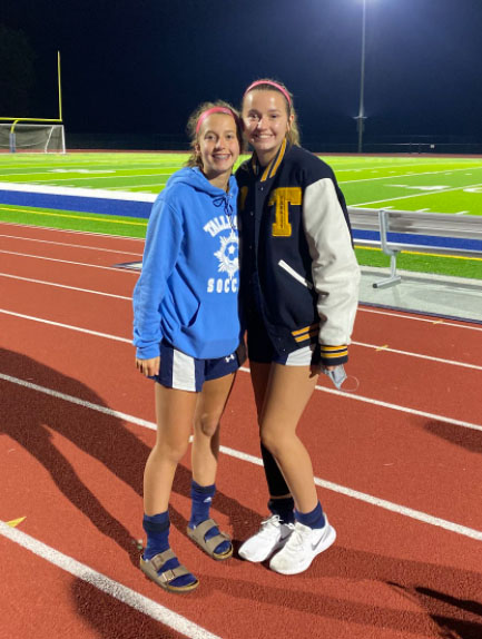 The Caruso sisters, freshman Abby (left) and senior Halle (right), pose for a picture together.
