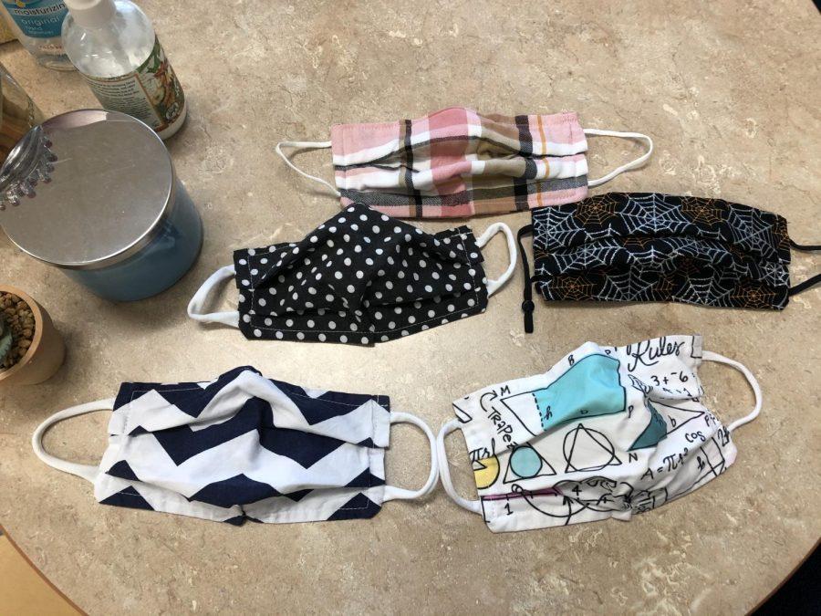 Teacher+Arene+Staszak%27s+collection+of+the+masks+teacher+Molly+Breiding+made+for+her.