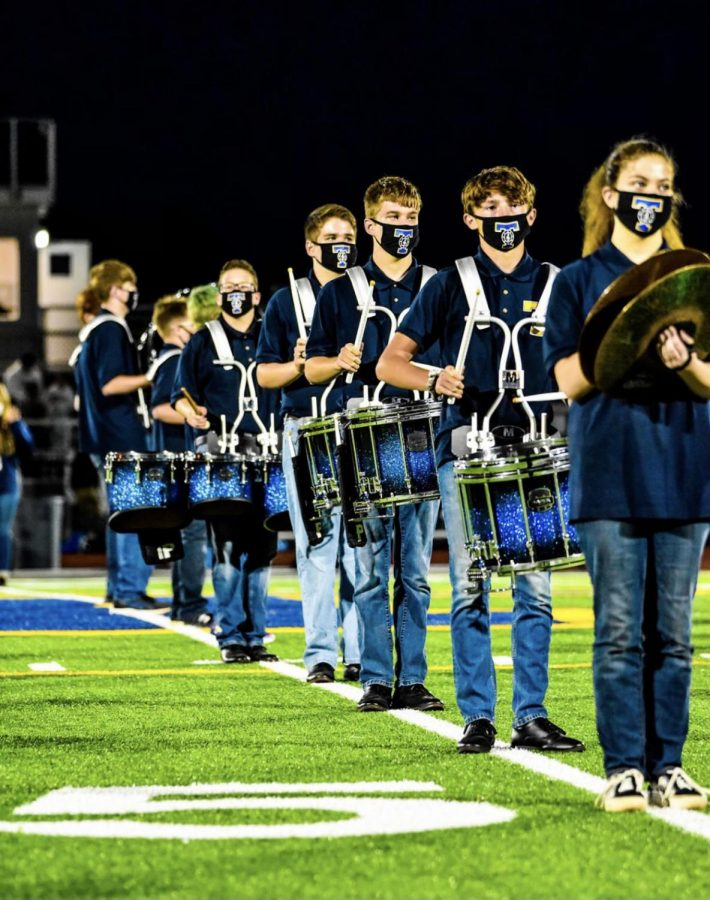 The Marching Band performs at halftime of the home football game.
