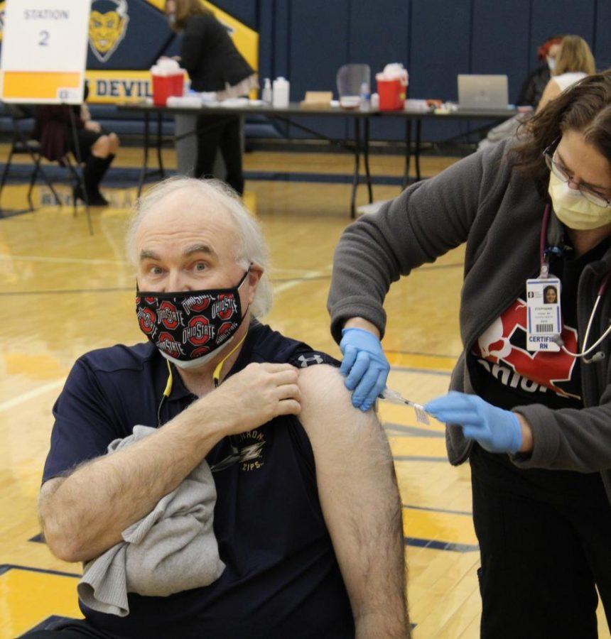 Teacher Jon Shomo enthusiastically receives the COVID-19 vaccine Feb. 3 in the Tallmadge High School Gymnasium.