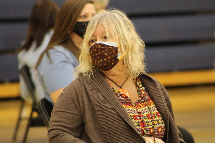 """After receiving the vaccine, teacher Joni Giles patiently waits fifteen minutes before she can leave the gymnasium.  """"I felt so extremely happy that I was half-protected from this virus and I can't' wait to get the next one,"""" Giles said. Staff members will receive their second dose Feb. 24."""