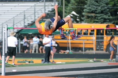 Junior Riley Murphy completes his high jump at a recent meet.